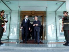 Abdullah Abdullah, Chairman of the High Council for National Reconciliation, walks with US Secretary of State Antony Blinken, at the Sapidar Palace in Kabul (Sapidar Palace via AP)