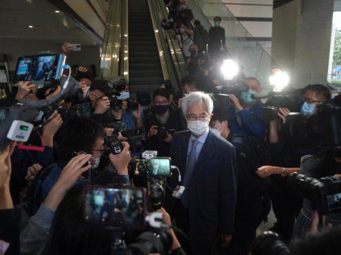 Pro-democracy activist Martin Lee, centre, arrives at a court in Hong Kong (Kin Cheung/AP)