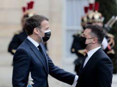 French President Emmanuel Macron, left, welcomes Ukrainian President Volodymyr Zelenskyy at the Elysee palace (Lewis Joly/Associated Press)