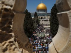 Palestinian worshipers pray during the first Friday of the holy month of Ramadan at the al Aqsa Mosque compound in Jerusalem's old city (Mahmoud Illean/AP)