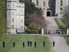 Police officers conduct security checks outside Windsor Castle, Berkshire (Andrew Matthews/PA)