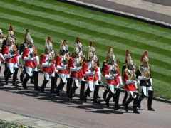 The Household Cavalry march outside St George's Chapel, Windsor Castle (Justin Tallis/PA)