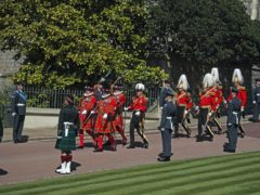 Members of the RAF and the 4th Battalion The Royal Regiment of Scotland line the route of the procession as members of the armed forces march past at Windsor Castle (Steve Parsons/PA)