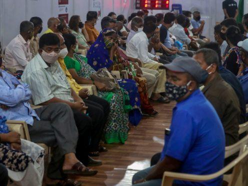 People wait to receive a vaccine in Mumbai, India (Rafiq Maqbool/AP)