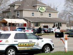 Officials investigate the scene of a deadly shooting at Somers House Tavern in Kenosh (Mike De Sisti/Milwaukee Journal-Sentinel via AP)
