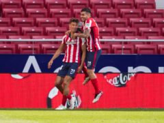 Marcos Llorente, left, and Angel Correa scored twice each in Atletico Madrid's win (Bernat Armangue/AP)