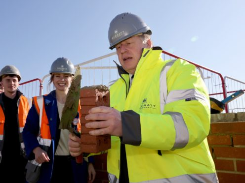Boris Johnson, who on Monday visited a Barratt Homes development in Gloucestershire, said he did not think it was good news for fans (Jonathan Buckmaster/Daily Express/PA)