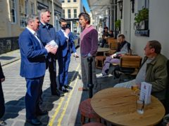 Sir Keir Starmer listens to Rod Humphris, landlord of The Raven pub in Bath (Ben Birchall/PA)