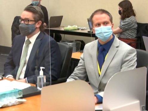 Defence lawyer Eric Nelson, left, and defendant Derek Chauvin at the Hennepin County Courthouse in Minneapolis (Court TV via AP/Pool)