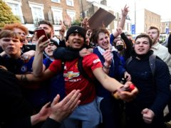 Fans react outside Stamford Bridge after the potential news that Chelsea are preparing to withdraw from the new European Super League (Ian West/PA)