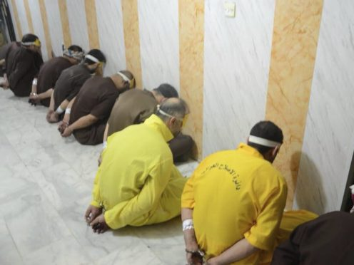 Blindfolded prisoners await their executions in Iraq (File/Iraq Ministry of Justice/AP)