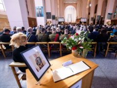 A portrait of Philip is displayed during a national memorial service in Wellington, New Zealand (Robert Kitchin/AP)
