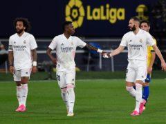 Real Madrid's Karim Benzema, right, celebrates after scoring against Cadiz (Jose Breton/AP)
