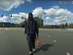This image from body-worn camera video provided by the Contra Costa Sheriff shows Tyrell Wilson, holding a knife in his right hand, approaching Deputy Andrew Hall in the middle of an intersection on March 11 2021 in Danville, California (Contra Costa Sheriff via AP)