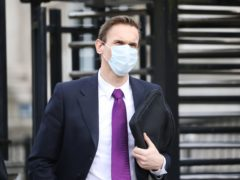 Television presenter Dr Christian Jessen leaves Belfast High Court after giving evidence in defamation proceedings taken against him by First Minister Arlene Foster (Peter Morrison/PA)