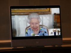 The Queen appears on a screen by videolink from Windsor Castle (Yui Mok/PA)