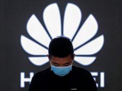 An employee inside a Huawei flagship store in Beijing (AP)