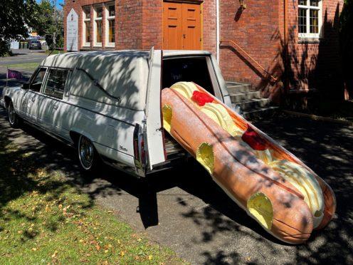 A cream doughnut shaped coffin (Ross Hall via AP)