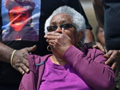 Jessie Hamilton reacts as she is presented with a cheque to pay off her mortgage (Hilary Scheinuk/The Advocate via AP)