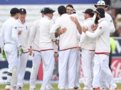 England's James Anderson celebrates after taking his 400th Test wicket (Martin Rickett/PA)