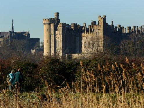 A couple enjoy a walk in the sunshine near Arundel Castle in Arundel, West Sussex, after one of the coldest nights of the autumn so far this year across England and Wales (Gareth Fuller/PA)