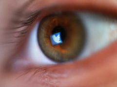 The Twitter bird logo reflected in a man's eye, in London. (Yui Mok/PA)