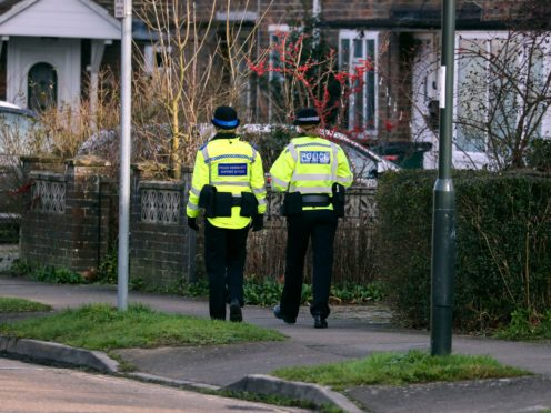There were 5.6 million crimes recorded by police in England and Wales in the 12 months, a fall of 8% compared with the 6.1 million the previous year (Steve Parsons/PA)