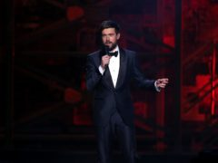 Jack Whitehall on stage at the Brit Awards 2020 (Isabel Infantes/PA)