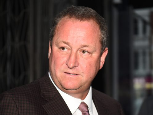 Newcastle owner Mike Ashley is fighting on two fronts to push through a takeover (Kirsty O'Connor/PA)