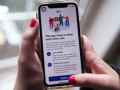 File photo dated 24/09/20 of the new coronavirus contact tracing app on an iPhone, which was launched across England and Wales, one of the major tech talking points of 2020.
