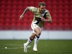 James Coppinger celebrates scoring for Doncaster (PA)