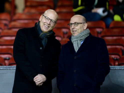 Manchester United co-chairman Joel Glazer, right, has written a letter to the club's supporters (Martin Rickett/PA)