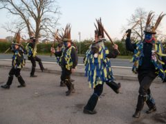 Members of the Hook Eagle Morris Men perform outside the Shack Cafe near to Hook in Hampshire (Andrew Matthews/PA)