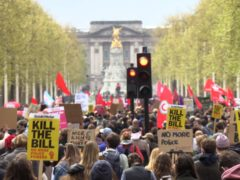 Demonstrators walk down the Mall during a 'Kill The Bill' protest (Renee Bailey/PA)