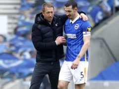 Brighton boss Graham Potter, left, was delighted with Lewis Dunk's display against Leeds (John Sibley/PA)
