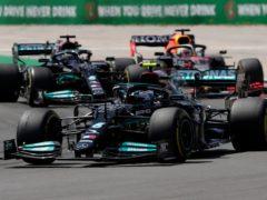 Hamilton (left) got the better of Bottas and Verstappen (AP Photo/Manu Fernandez)