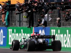 Lewis Hamilton raced to victory in Portugal on Sunday (Manu Fernandez/AP)