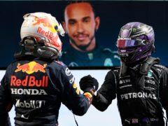Lewis Hamilton and Max Verstappen shake hands after the race (Gabriel Bouys/AP)