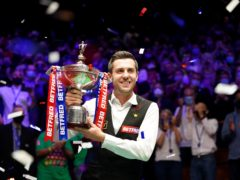 Mark Selby celebrates his victory over Shaun Murphy (Zac Goodwin/PA).