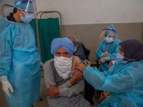 A Kashmiri man receives a vaccine for Covid-19 (AP)