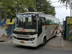 A bus assigned for transporting the members of broadcast team leaves Arun Jaitley Stadium (Ishant Chauhan/AP)