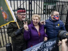 Supporters of the two veterans accused of the murder of Joe McCann in 1972 celebrate after hearing the case at Laganside Court in Belfast has collapsed (PA)