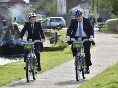Boris Johnson and mayor for West Midlands Andy Street ride bikes along the towpath of the Stourbridge canal (Rui Vieira/PA)