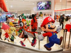 Nintendo characters, including Mario, on the window of it store in Tokyo (AP)