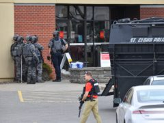 Four bank employees were released as a stand-off between an alleged hostage-taker and police continued in Minnesota (Dave Schwarz/St Cloud Times/AP)