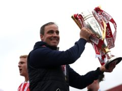 Michael Duff celebrates with the League Two trophy (Bradley Collyer/PA)