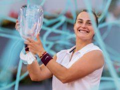 Aryna Sabalenka holds the Madrid Open trophy aloft (Bernat Armangue/AP)