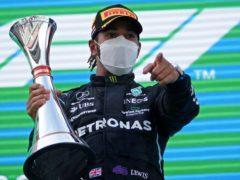 Lewis Hamilton celebrates on the podium (Emilio Morenatti/AP)