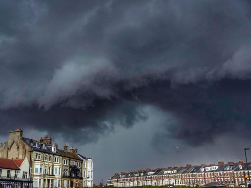 Storm clouds roll in over Tynemouth in the north east of England (Owen Humphreys/PA)