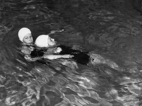 The Queen training for her junior respiration award in February 1941 (Royal Life Saving Society/PA)